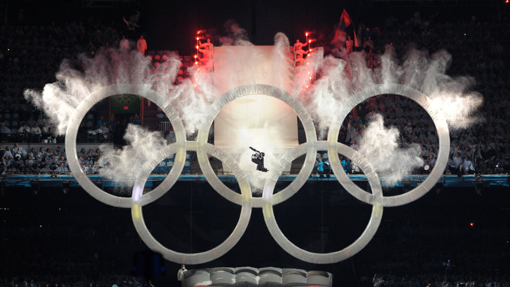 12.02.2010, Whistler, Canada (CAN): Snowboarder jumps through Olympic Rings at the beginning of the ceremony A snowboarder jumps through the olympic rings - XXI Olympic Winter Games Vancouver 2010, opening ceremony, Vancouver (CAN). www.nordicfocus.com. © NordicFocus. Every downloaded picture is fee-liable.