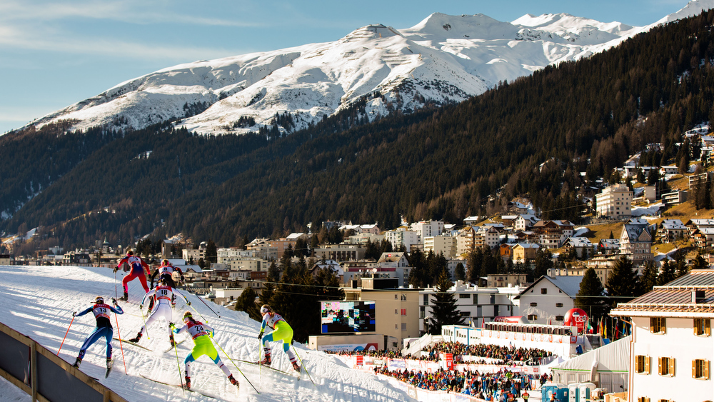 21.12.2014, Davos, Switzerland (SUI): a group of skiers at the track with panorama towards the village - FIS world cup cross-country, individual sprint, Davos (SUI). www.nordicfocus.com. © Laiho/NordicFocus. Every downloaded picture is fee-liable.